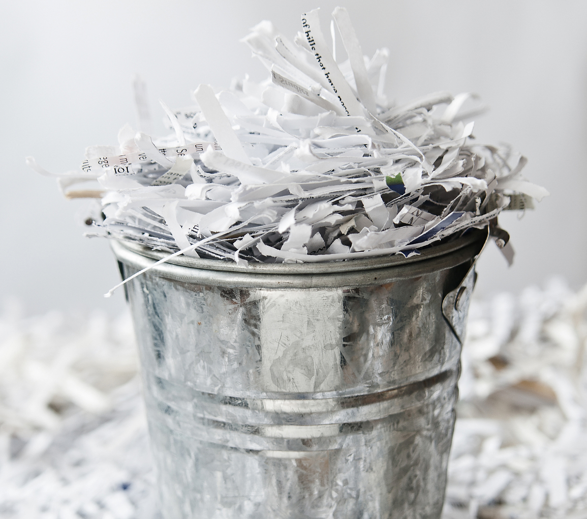 Bucket of shredded paper