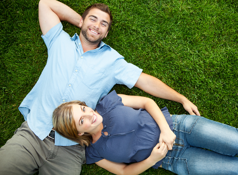 Couple laying grass