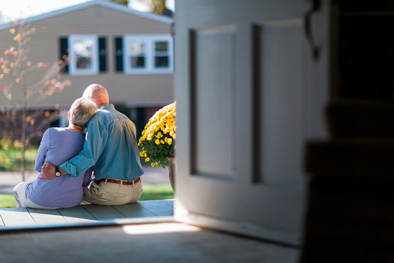 Senior couple sitting on porch