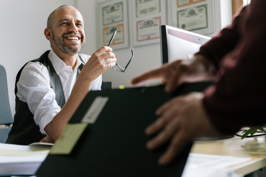 Man smiling at office desk