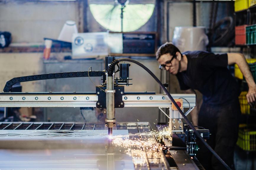 Man working on manufacturing machine