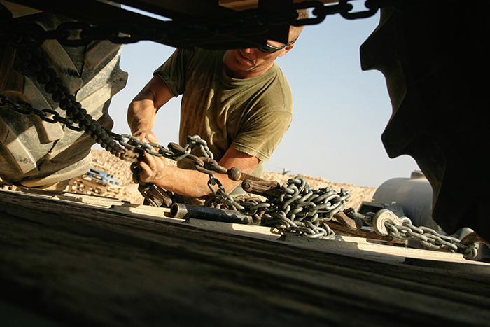 Military veteran strapping down truck