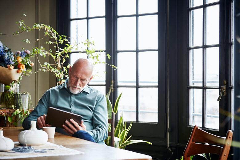 Elderly man using a tablet
