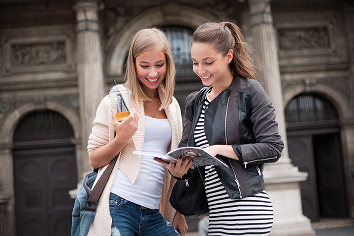 Two student looking at a notebook