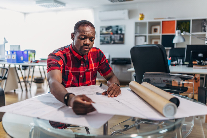 Man working with plans on a table
