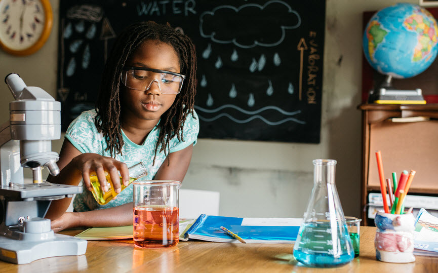 Girl doing chemistry in science class