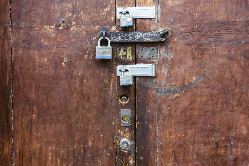 door with multiple padlocks